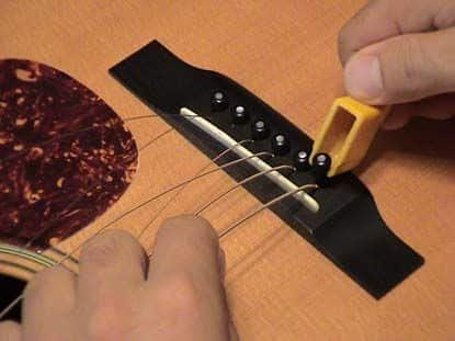how to lower the action on acoustic guitar