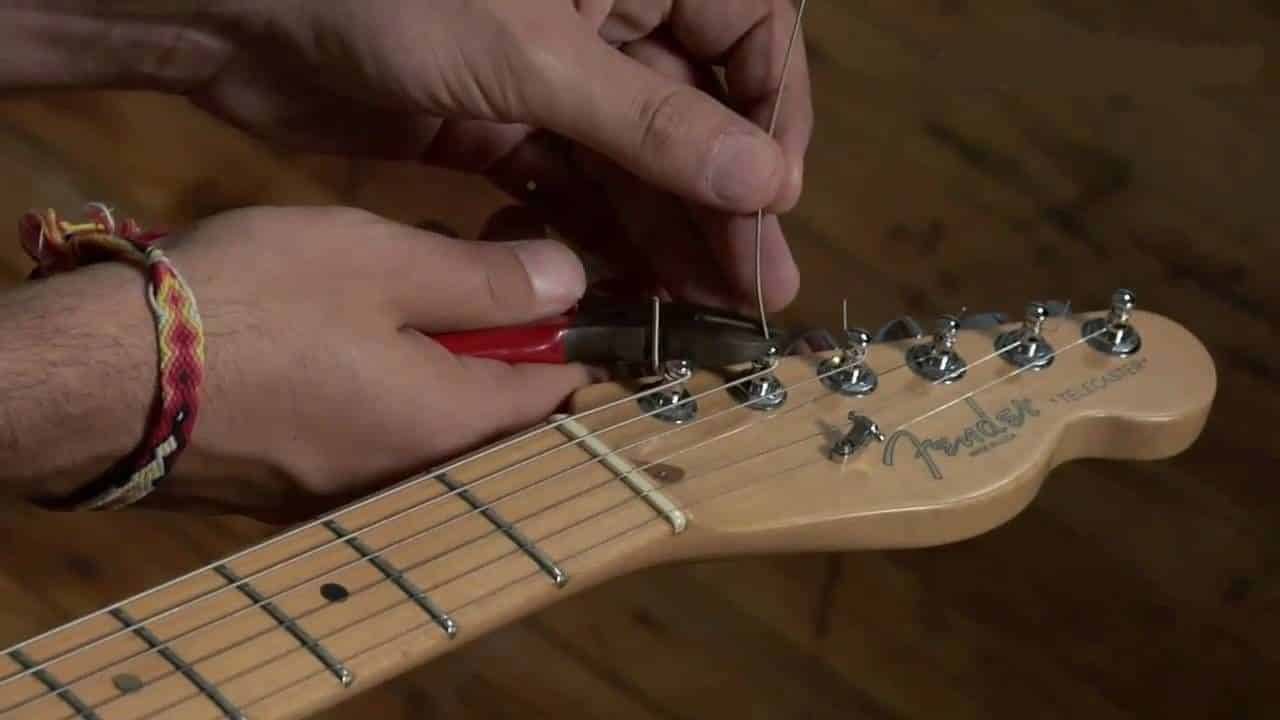 how to restring an electric guitar
