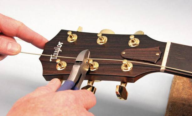 remove old strings - HOW TO STRING A GUITAR