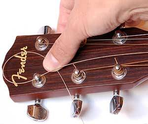 string guitar - HOW TO STRING A GUITAR
