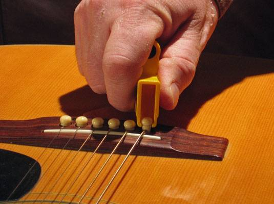 string winder - HOW TO STRING A GUITAR